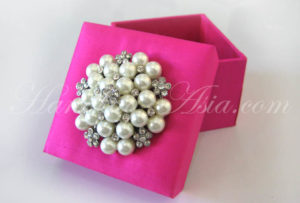 Silk wedding favor box with pearl brooch