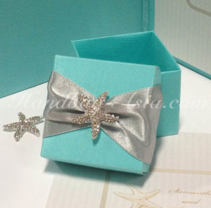 Handmade tiffany blue silk favor box with starfish brooch