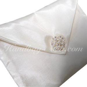 Ivory silk wedding envelope with pearl brooch