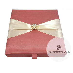 wedding invitation box with pearl brooch